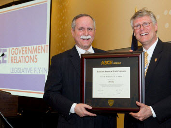 Rep. David McKinley of West Virginia, a civil engineer and Society member, is honored for achieving Fellow status by 2013 President-elect Randall Over