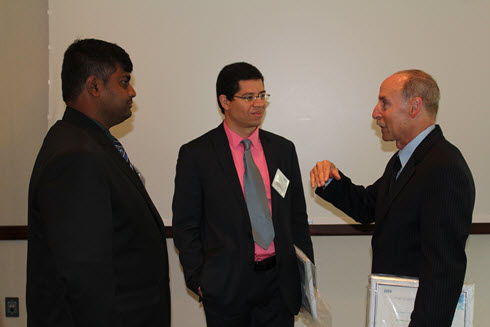 Innovation Contest winners, from left, Mayur Pole, Samer Dessouky, and Mark Capron compare notes at the Green Engineering event.
