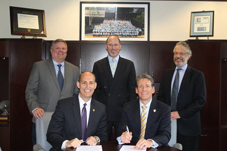 ASCE and Smart City Works have signed a memorandum of understanding. Pictured, front row from left, ASCE Executive Director Tom Smith and Smart City Works founder Greg Satuer; back row, ASCE Senior Managing Director John Durrant, and Smart City Works founders David Heyman and Robert Mazer.