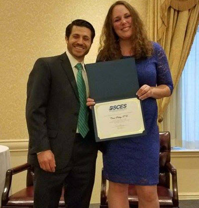 Cara Pirkey, P.E., M.ASCE, receives the Bertram Berger Young Engineer of the Year Award during the Bertram Berger Seminar. PHOTO: Boston Society of Civil Engineers Section