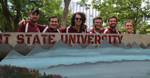 "Members of the Fairmont State University stand behind their ""Mountain Mama"" canoe."