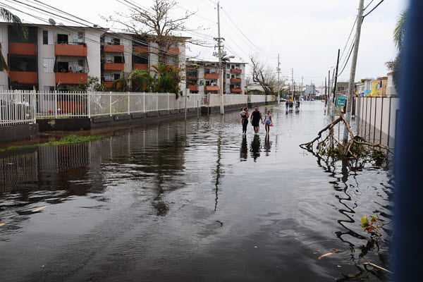 Puerto Rican residents walk in flooded streets in Condado, San Juan, Puerto Rico. PHOTO: Dept. of Defense