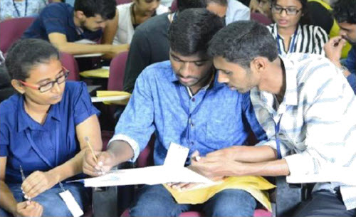 Contest participants compare notes as they try to win the Step the Zone competition at the 2017 Concrete Fair.PHOTO: Kushal Runthala