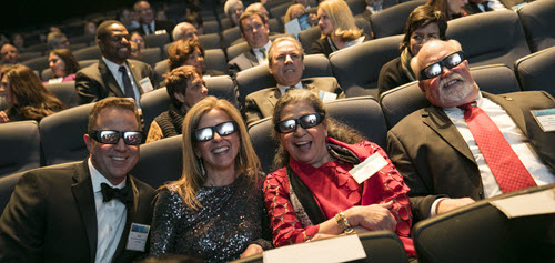 ASCE's 2017 President-Elect Kristina Swallow and Past-President Mark Woodson settle into their theater seats with their respective spouses, David and Lupe, donning Dream Big 3D glasses. Courtesy Jason Dixson Photgraphy