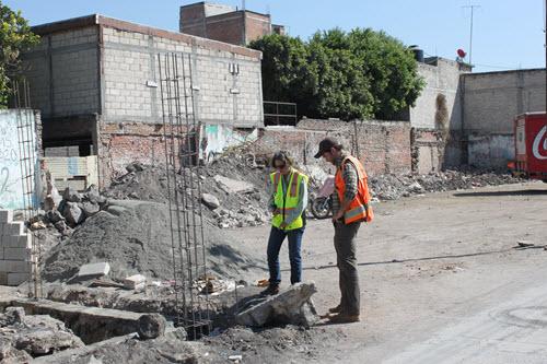Team members Janise Rodgers and Jeff Bruce observe rebuilding work in Jojutla.