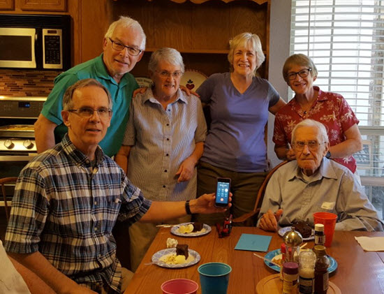 The Kralik family enjoys a moment together last spring. From left, Dean Sheridan, David Sheridan, Susan Sudduth, Nancy Kralik, Carol Belfiore, and Marlin Sheridan. Anne Fannan, the sixth child of Marlin and Betty, is on the phone. PHOTO: Nancy Kralik