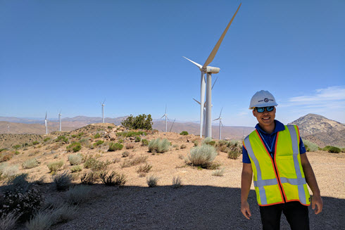 Picture of Paul Lee in front of renewable energy