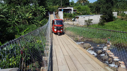 The first moto taxi to cross the bridge, providing lifesaving access to the health center.
