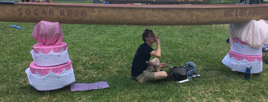 """Competitors got creative when it came to finding shade during the hot Display Day, even under UCLA's """"Sugar Rush"""" canoe."""