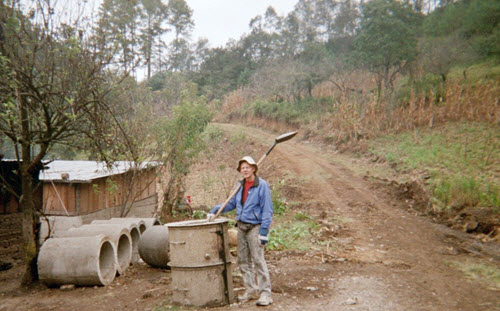 photo of man holding shovel