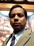 headshot of Karim