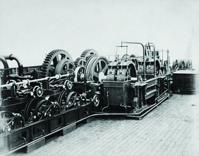 old photo of a cable-laying machine