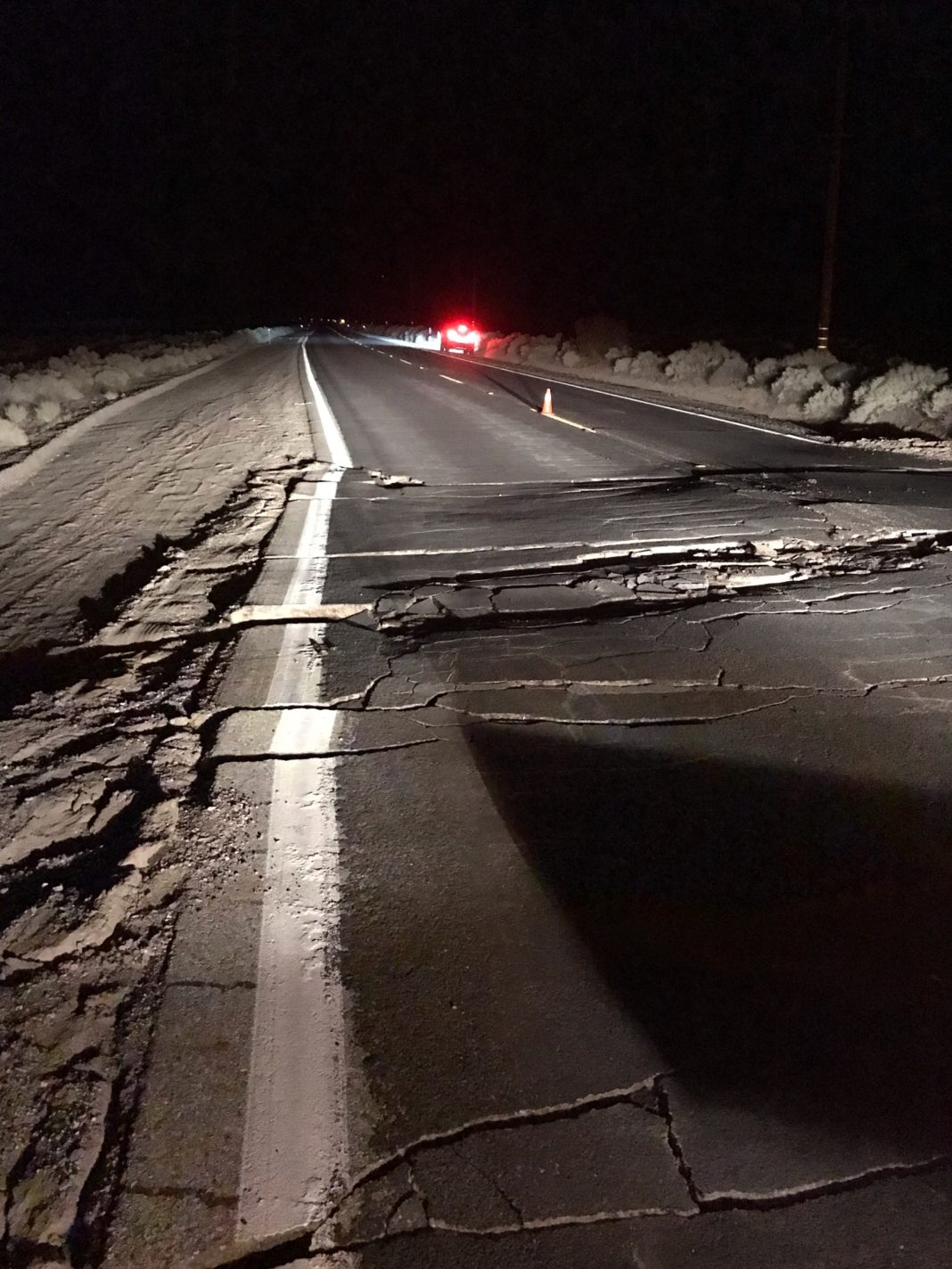 damaged roadway at night