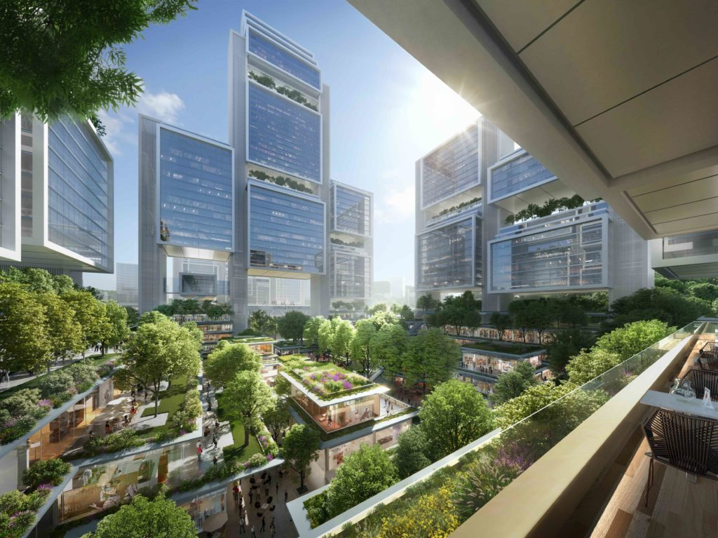 greenery in a plaza that is bounded by glass-faced towers of various sizes