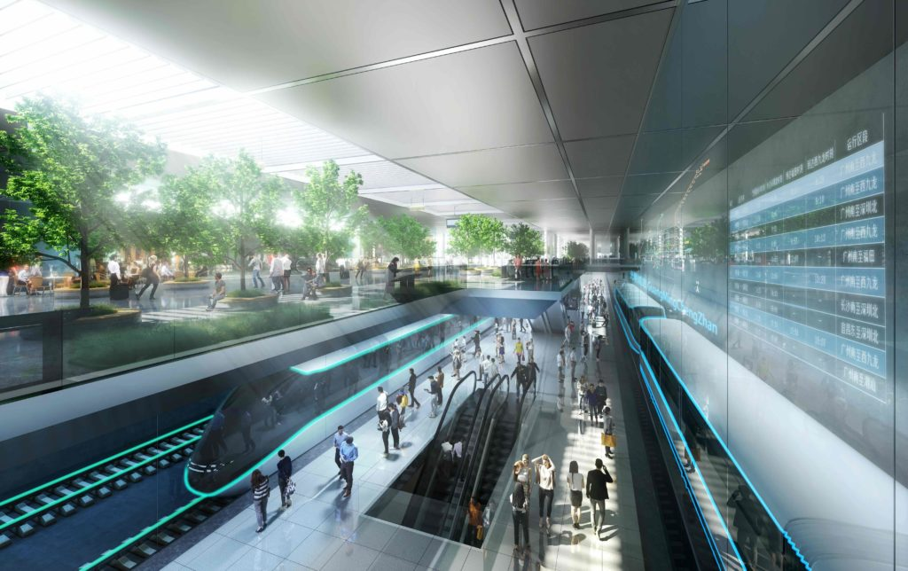 a sunken, interior high speed train station with multiple tracks, pedestrians, and greenery drenched in sunlight