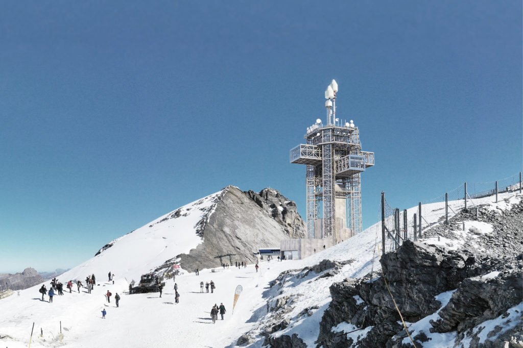 converted telecommunications tower on a snow covered mountaintop with two cantilevering levels