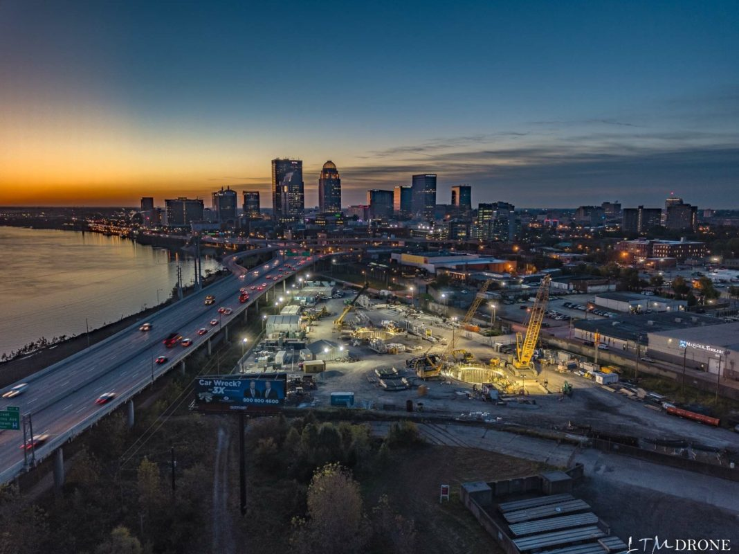 aerial of tunnel and cityscape at dusk