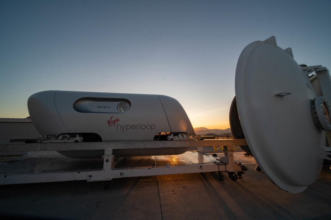 virgin hyperloop test pod, track, and tunnel against the setting sun