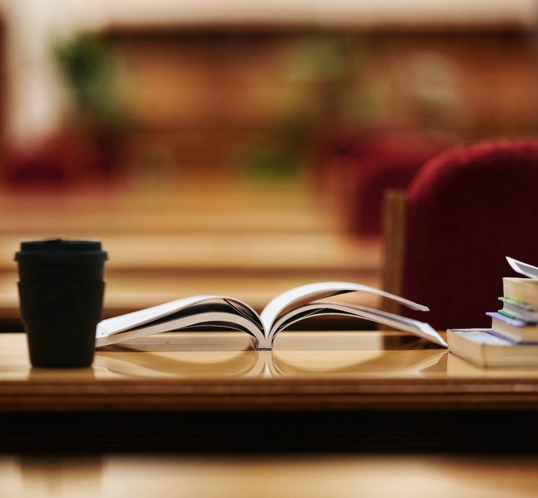 photo showing books and an open notebook on a table