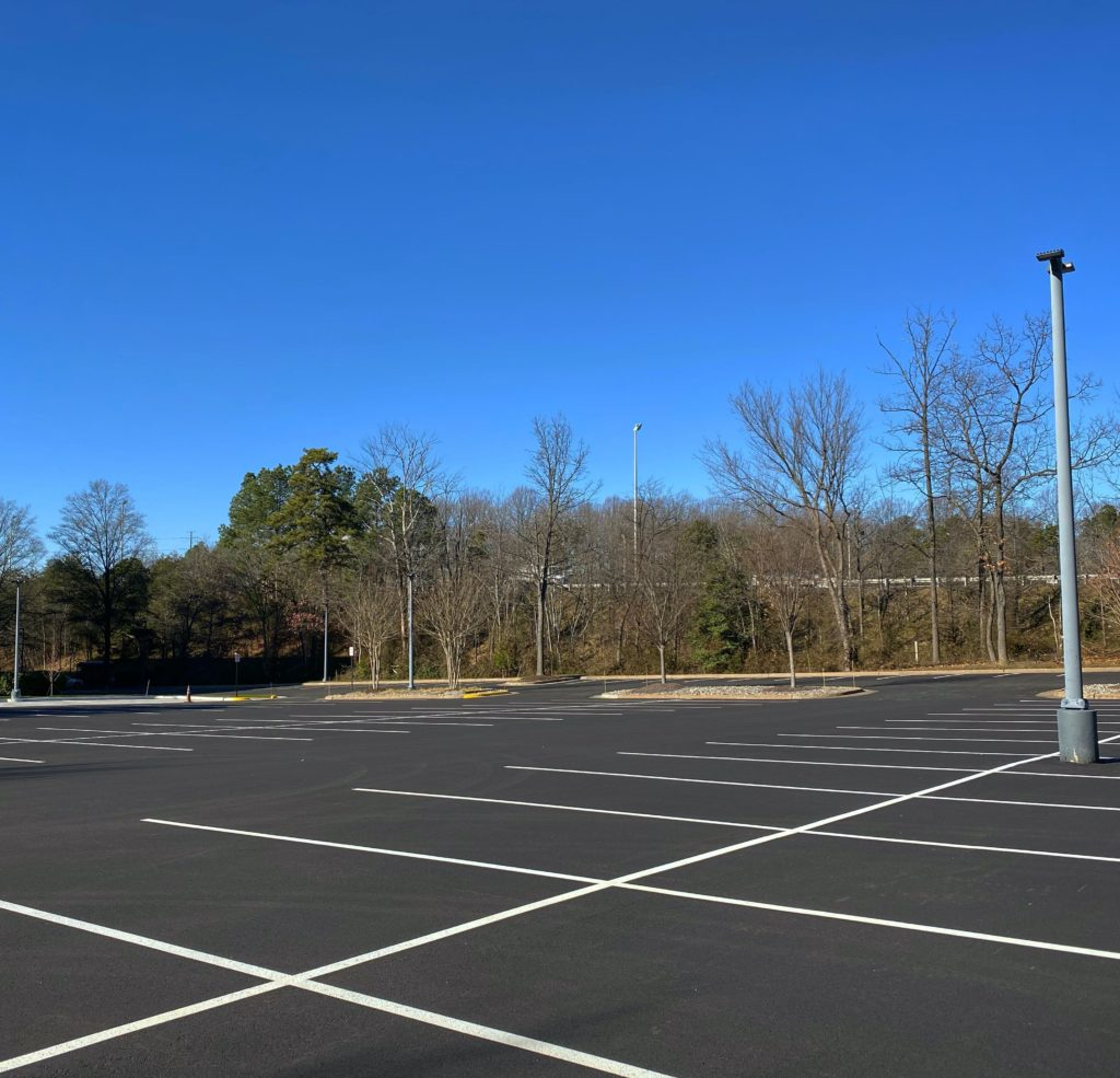 parking lot paved with asphalt made from recycled tires
