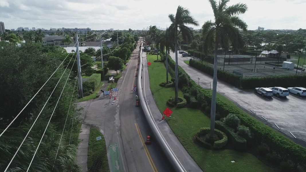 aerial of pipe extended along a roadway