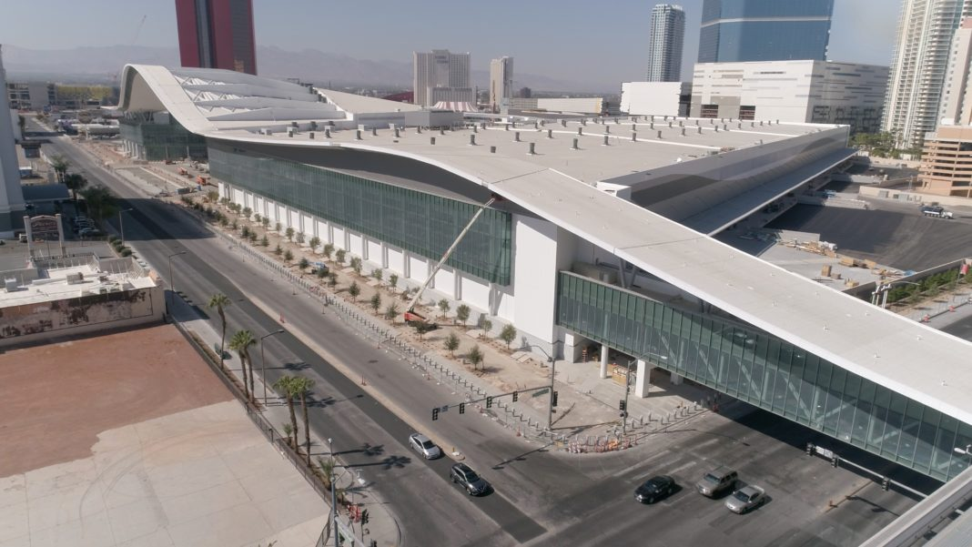 a ribbon-like roof extends along the top edge of a convention center