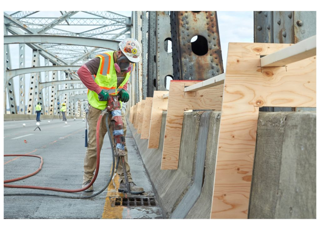a construction worker works on the deck