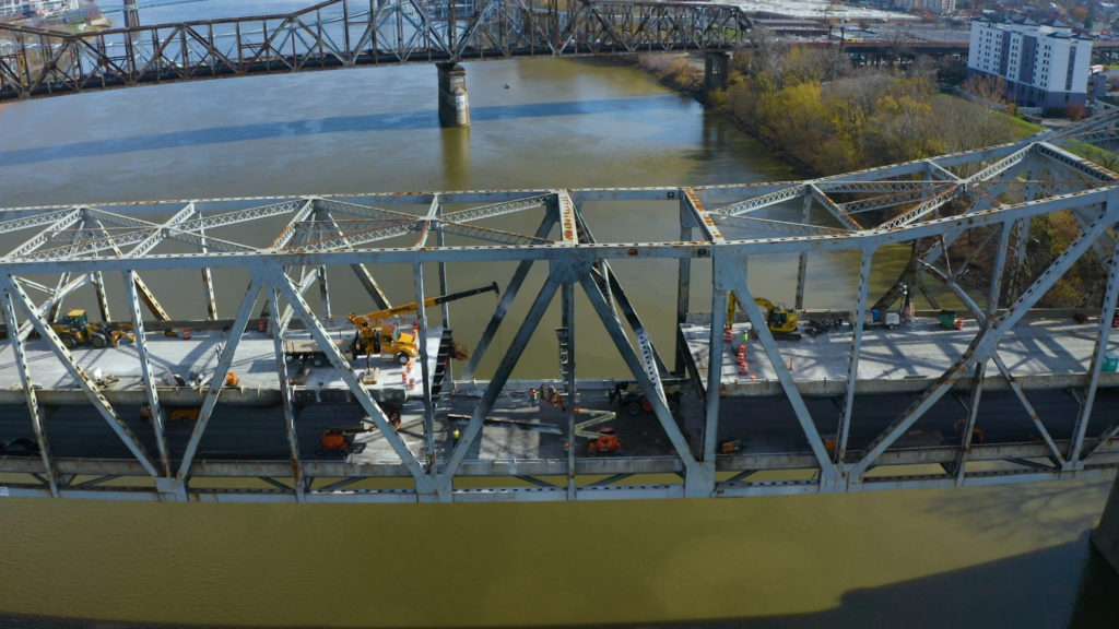 aerial of double decker bridge with section of deck removed