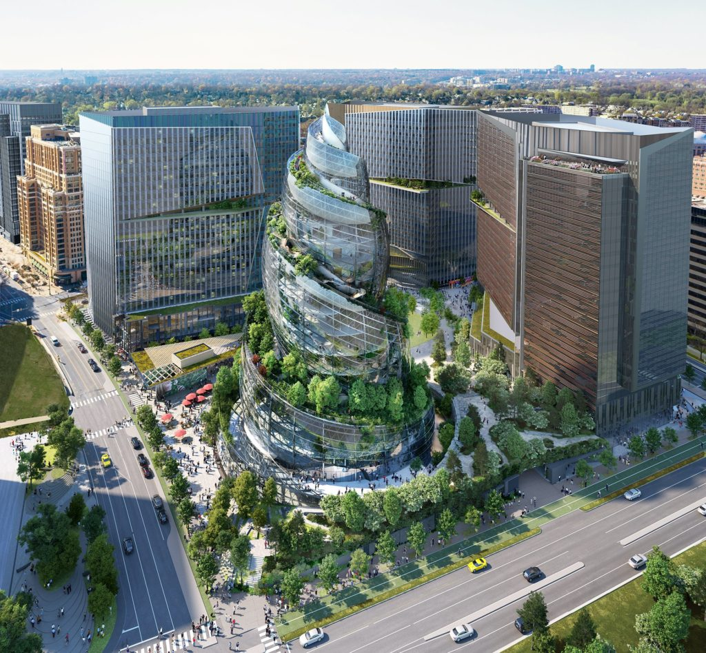 aerial shot of a glass helix tower with landscaped walking paths that wind up the building