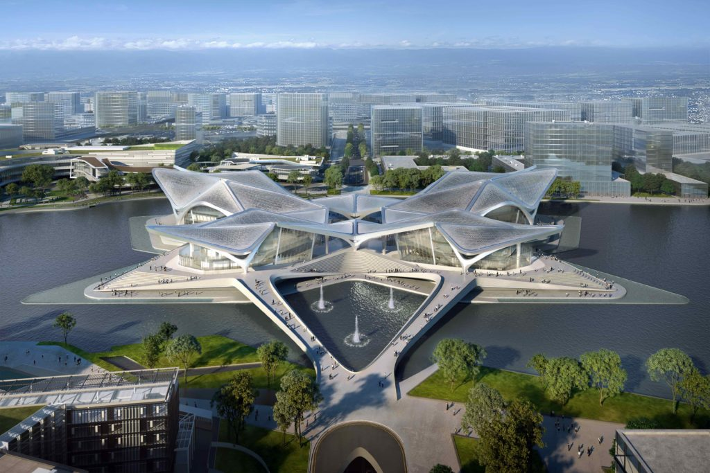 looking down at the pedestrian bridges that lead to a star-shaped building located in a lake