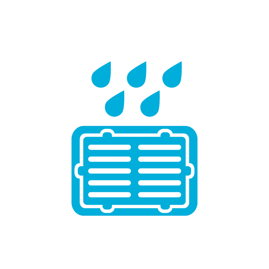 image of a stormwater grate with raindrops falling in it