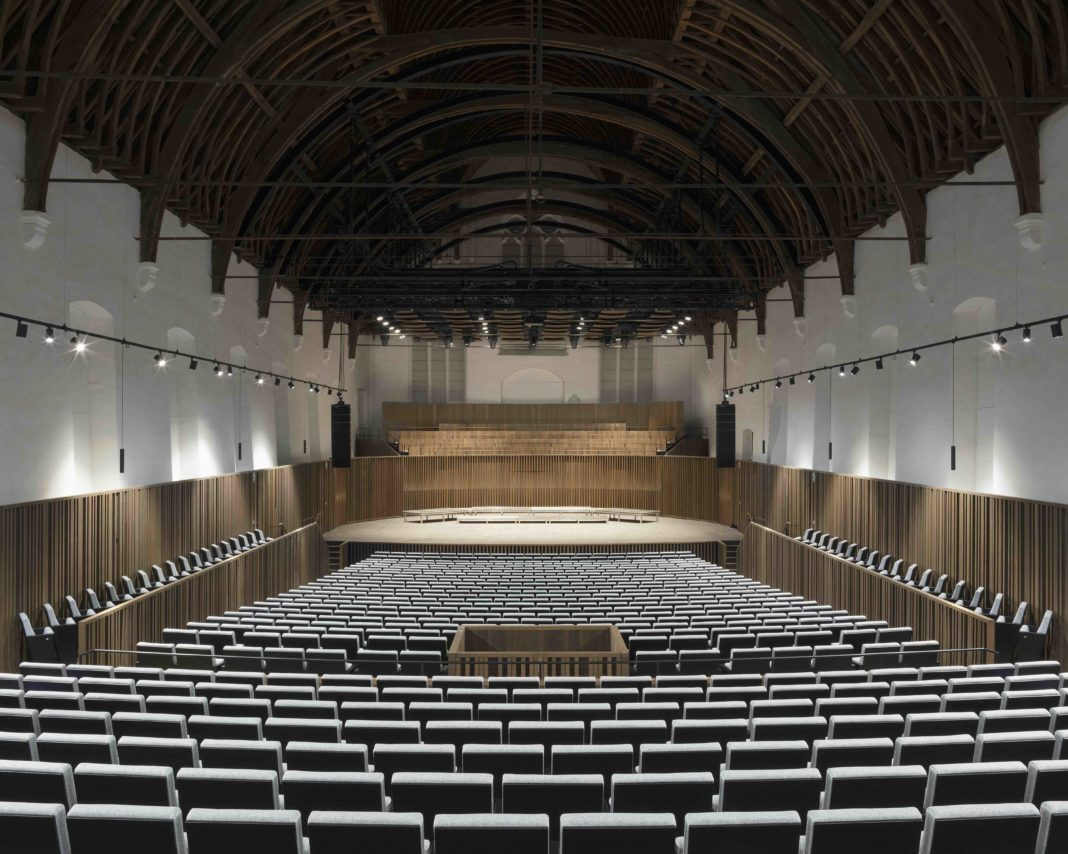 view from the back of a concert hall, looking at the stage
