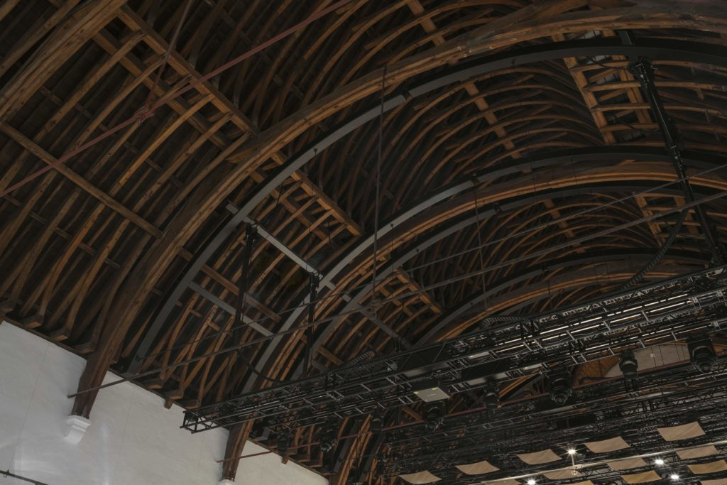 looking up at a historical timber roof with a new steel structure installed
