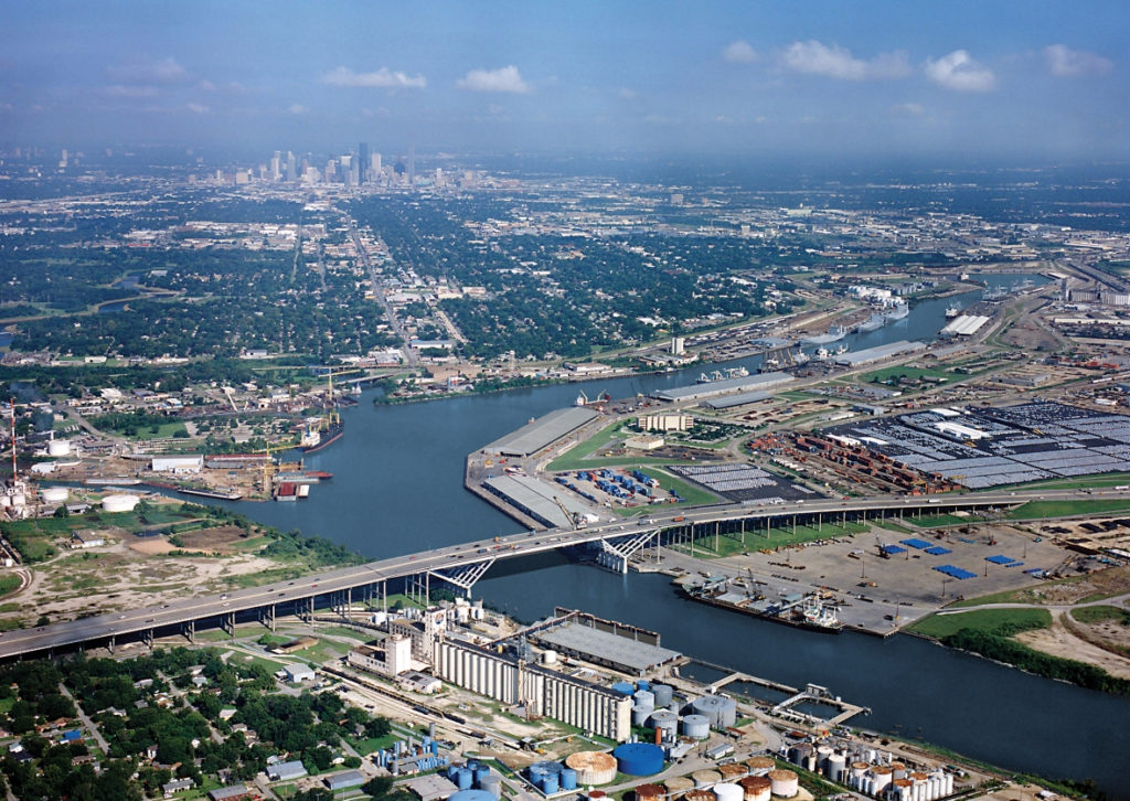 aerial shot of ship channel with Houston skyline in background