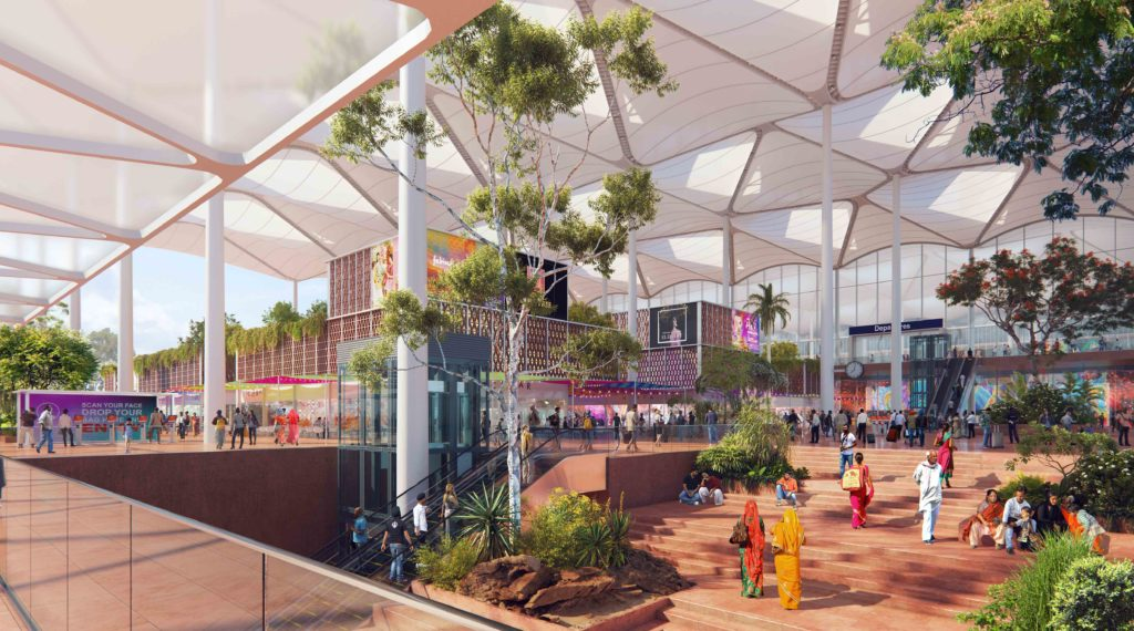 looking at an open air forecourt, with escalators delivering arriving people and an expansive white canopy providing shade
