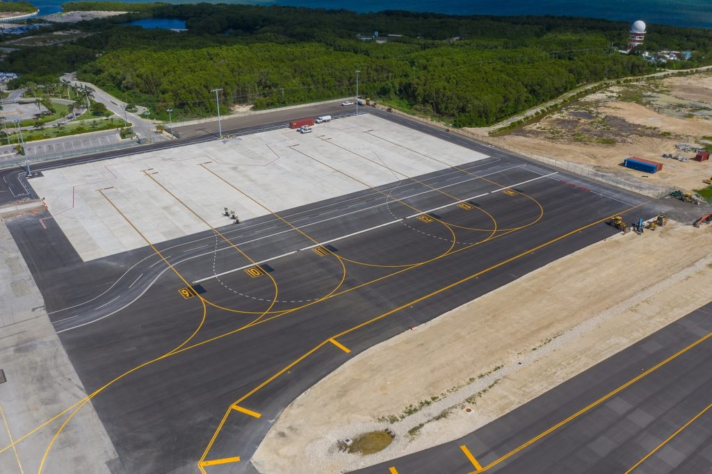 elevated view looking down at four concrete parking spaces for aircraft