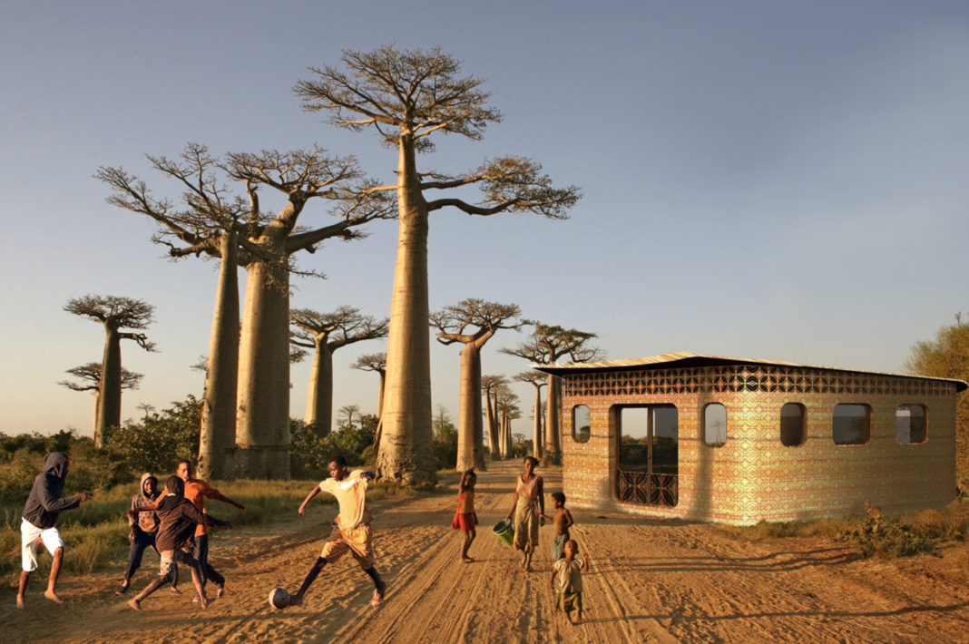 children play under trees and outside a one story building in an arid climate
