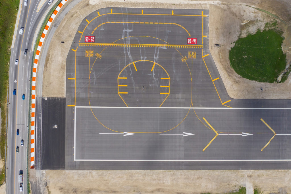 aerial view of the new taxi turnaround, with a road curving around its left and upper sides