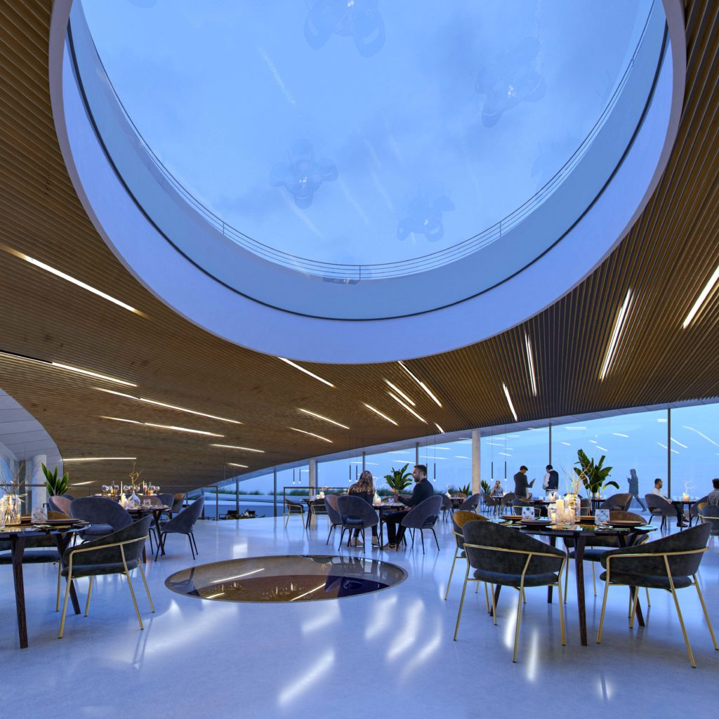 a beautiful modern room with sleek lines, a wooden roof with an enormous glass oculus and a long glazed wall