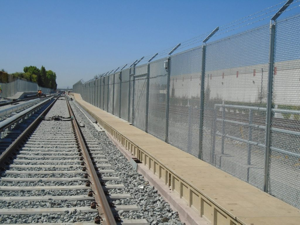 photographing showing the fence separating the BART and Union Pacific railroad tracks on the Berryessa extension
