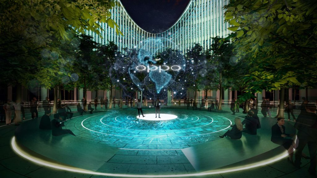 an enclosed plaza is lit with turquoise light and ringed with trees