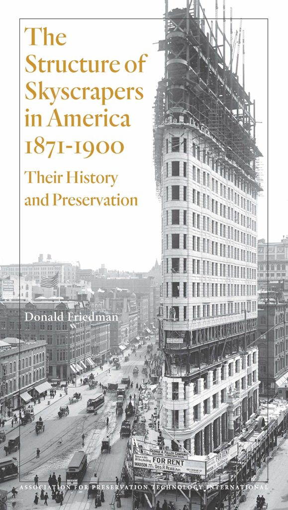 black and white book cover with gold print and photograph showing a tall, thin, ornate building