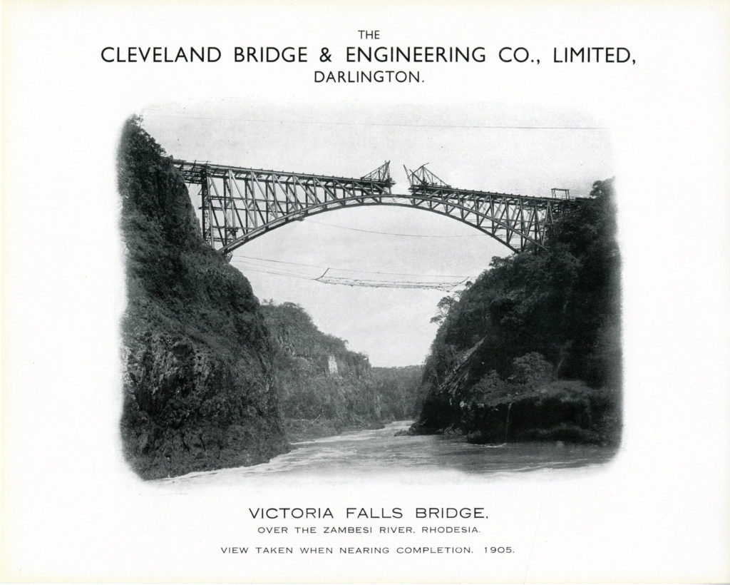 cantilevered construction shot of the two sides of the victoria falls bridge almost connected