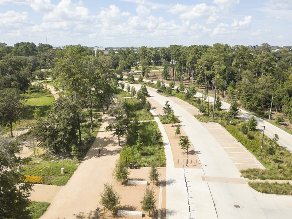 close up shot of walkways, green spaces, and trees at a national park