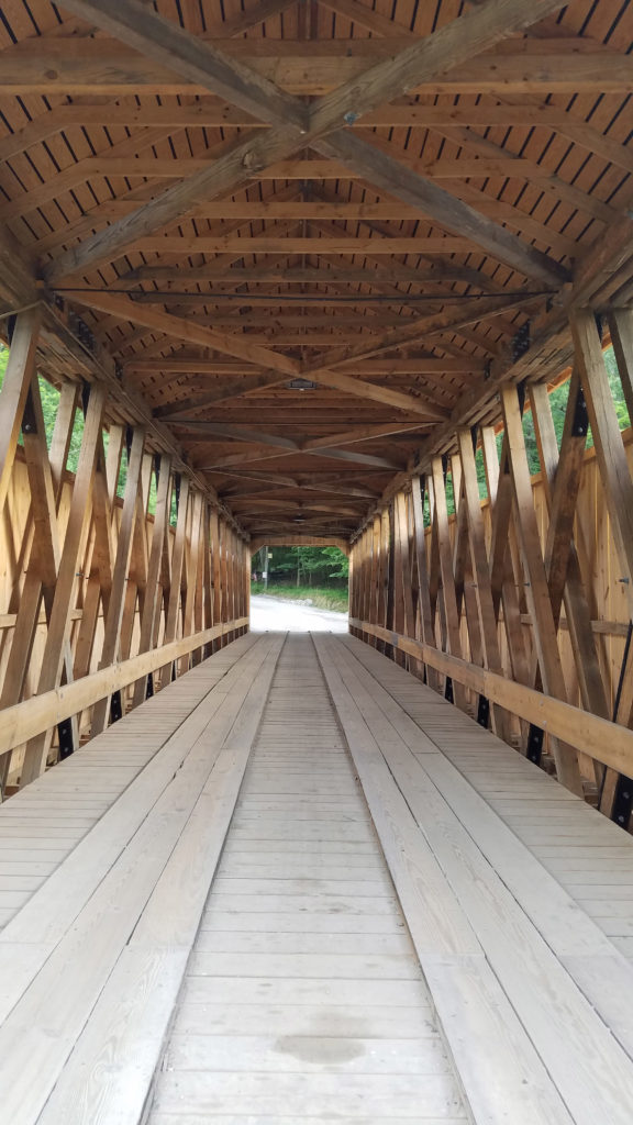 interior shot of new bridge showing the beams comprising the roof, sides, and the wheel path