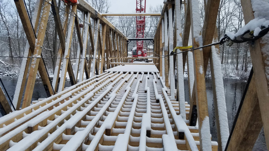 snow covered bridge during construction