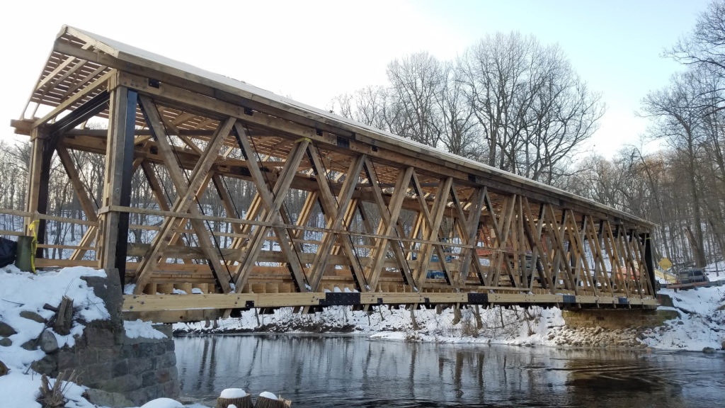 in construction photo of a one lane wooden bridge