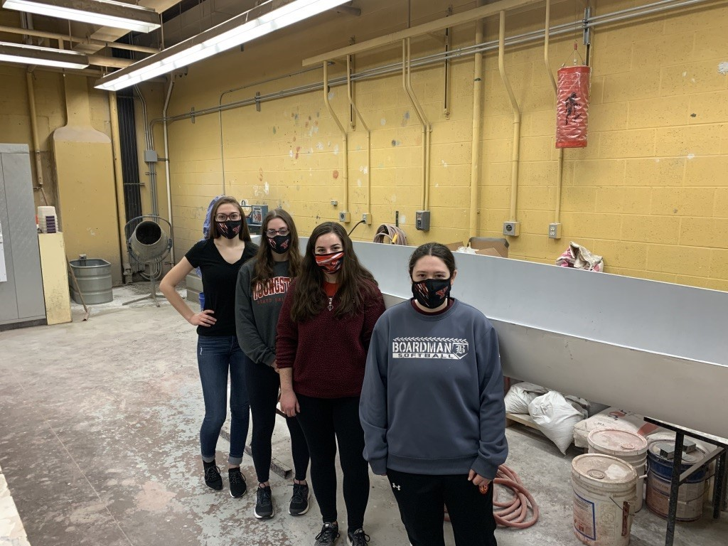 """The YSU team and their canoe, """"Malice Striker,"""" secure the win at the 2021 Ohio Valley Student Conference. PHOTO: Youngstown State University concrete canoe team"""